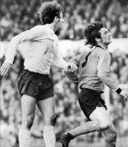 Hibbitt in a tussle for possession with Martin Peters in a Tottenham v Wolves clash.