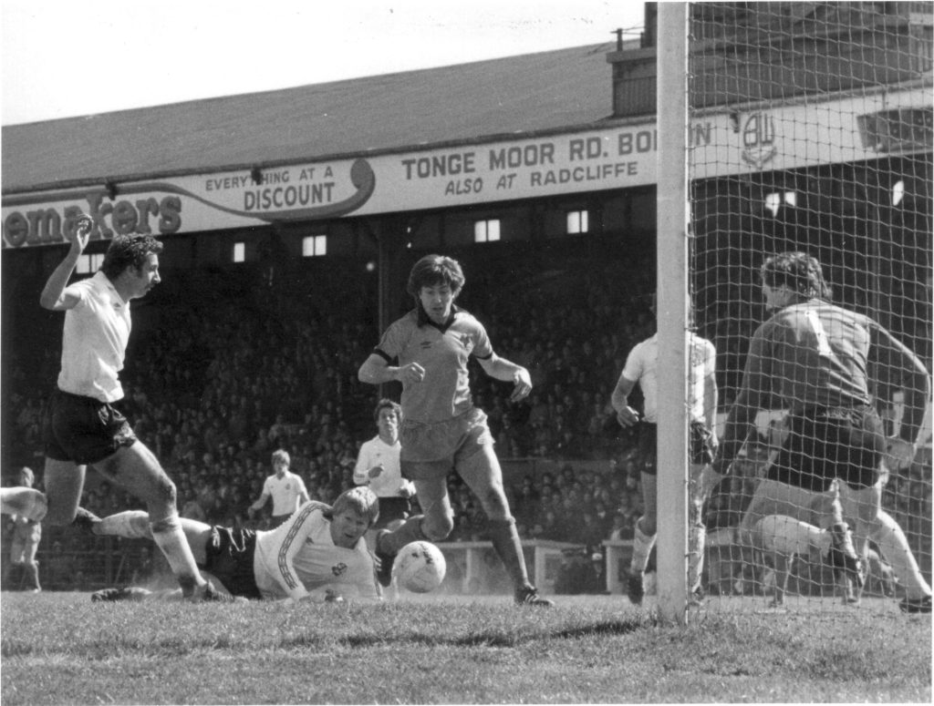 John Richards challenges in the deadlock at Burnden Park in May, 1980.