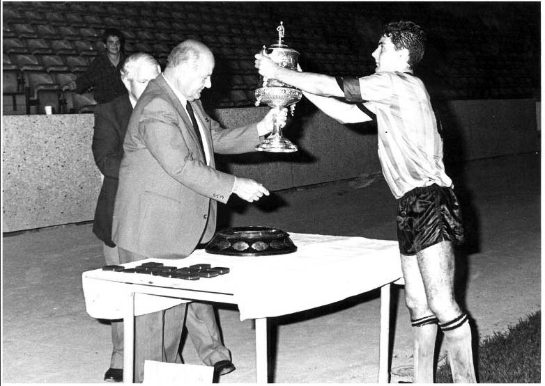 Matt Forman in the late 1980s - collecting the Birmingham Senior Cup as Wolves captain.