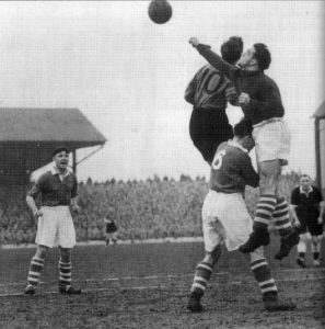 The inside-forward challenges in a game at Middlesbrough in 1950.