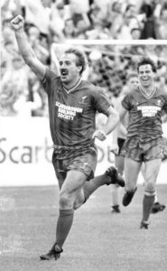 An historic day......Phil Robinson looks on as Scarborough celebrate one of their goals in the 2-2 draw with Wolves on the opening aftrenoon of 1987-88.